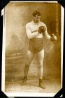 Photograph of a man in a boxing pose, captioned: A. Croucher, Middleweight champion [ ] South of England; endorsed: Prisoner of war, Rennbahn Camp, Munster, Germany, 7/12/15, A[lbert] Croucher, 16 Dea