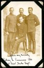 Photograph of four unidentified soldiers, prisoners of war, signed: yours very sincerely Sydney L. Summers Company Sergeant-Major, 1st Royal Berkshire Regiment; endorsed: To an interesting companion a