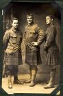 Photograph of three unidentified soldiers from Scottish regiments, prisoners of war, c.1916