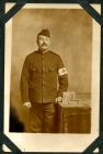 Photograph of a French medical orderly, a prisoner of war, endorsed: A mon ami Jas. W. Fish souvenir de captivite, Loridan J. Bte, 30 Rue de Beauvais, Courcoing, Nord., c.1914-18