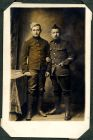 Photograph of a soldier and a corporal [French], prisoners of war, endorsed: Gustape Leroy, Rue Laponnerasie, no 28 a Cours (Toulre et Loire) Barrier Raoul 18 Rue de Bastes, St Pierre des Corps extra,