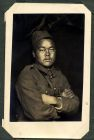 Photograph of a prisoner of war [Asian], at Rennbahn, Munster, Germany, c.1914-18