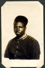 Photograph of a prisoner of war [African], at Rennbahn, Munster, Germany, c.1914-18
