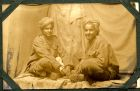 Photograph of two [Indian] soldiers, prisoners of war, at Rennbahn, Munster, Germany, c.1914-18