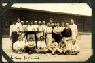 Photograph of a group with tennis racquets, prisoners of war at Rennbahn, Munster, Germany, signed Les vieux groguards!; endorsed: A mon vieux Jimmy, tres amicale meut, espere rencontre le Hapre en 19