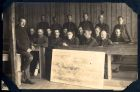 Photograph of an unidentified group of soldiers in a classroom, at Rennbahn, Munster, Germany, c.1914-18
