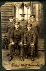 Photograph of a group of soldiers, Munster, Germany, captioned: postal staff, Munster; endorsed: To Jim with good wishes and remembrances of a long stay in the continent from Percy Bramwell, Rennbahn,