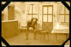 Photograph of a scene from a play taken at Rennbahn prisoner of war camp, Munster, Germany, c.1914-18