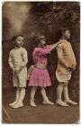 Postcard photograph of two boys and a girl in an informal group, from Private Fred Lucas, Italy, to Master Fred Lucas, Black Horse, Low Fell, Gateshead, informing 'that we are on the move now; it is v