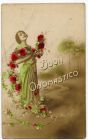 Postcard photograph of a young woman decorated with flowers, captioned: Buon onomastico, from Private Fred Lucas, Italy, to Master Fred Lucas, Black Horse, Low Fell, Gateshead, 13 August 1918
