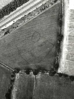 Aerial view showing cropmarks of an enclosed settlement near Spital Hill. Photo © Tim Gates.