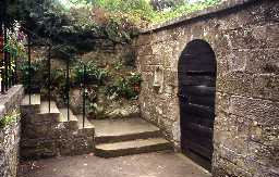 North wall of a possible bastle and reset piscina in garden wall at Whitton Grange, Tosson. Photo by Peter Ryder.