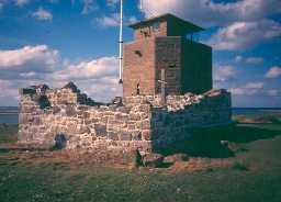 Chapel of the Lamp, with coastguard lookout behind, on Holy Island. Photo by Northumberland County Council.