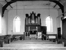 The inrterior of Slaggyford Wesleyan Methodist Church showing dais and organ . Photo by Peter Ryder.