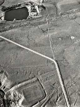 Aerial view of Roman camps by the Haltwhistle Burn with the fortlet at the bottom of the image. Photo © Tim Gates.