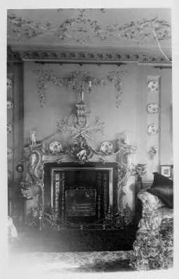 Coxhoe Hall interior. Ornate plasterwork fireplace c.1910