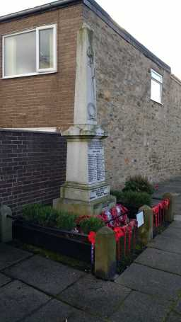 Photo to left of War Memorial Obelisk, High Street, Howden-le-Wear 2016