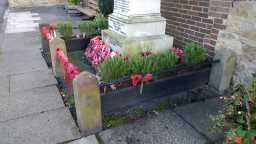 Photo of base of War Memorial Obelisk, High Street, Howden-le-Wear 2016