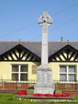 Closer in oblique view of front face of War Memorial Cross, High Street, Cornforth April 2016