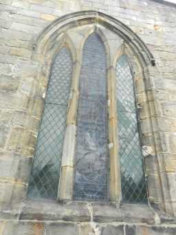 Close up photograph of arched window on St. Mary's Church 2016