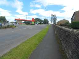 Photograph of wall and Milestone, Bede Road, Barnard Castle 2016