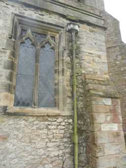 Photograph of square window and pipe at St. Mary's Church 2016