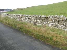 Photograph of wall and Milepost 2016
