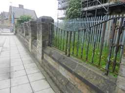 View along pavement of Railings & Piers 2016